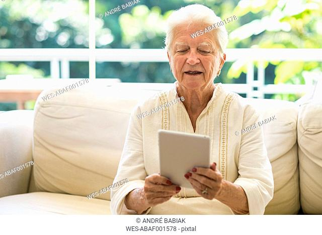 Portrait of senior woman using digital tablet