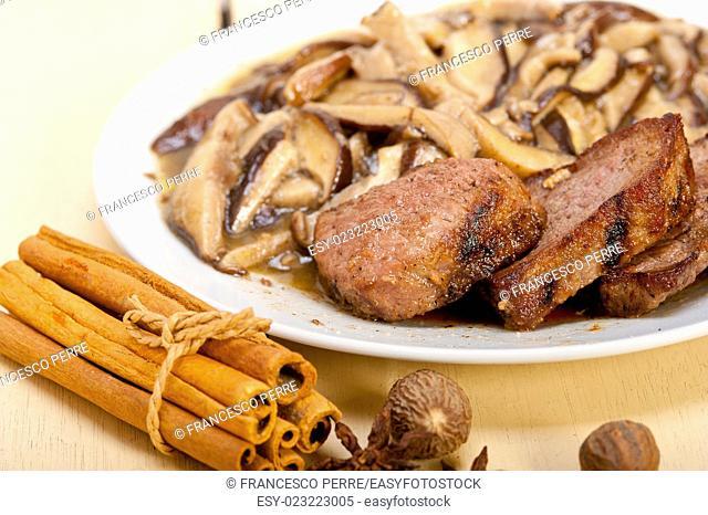 venison deer game filet tenderloin and fresh wild mushrooms