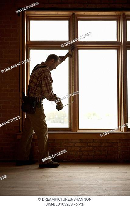Caucasian carpenter working on construction site