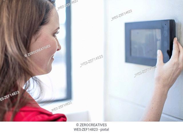 Woman using touchscreen on he wall