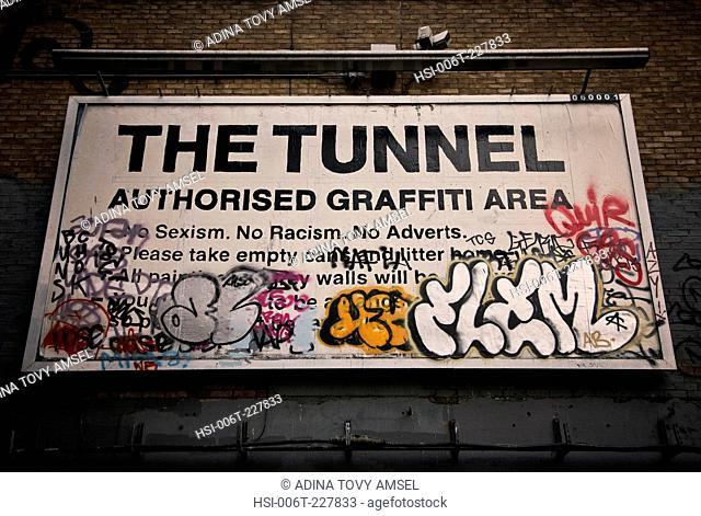 United Kingdom. England. London. Humorous sign on underpass. The Tunnel Authorised graffiti area