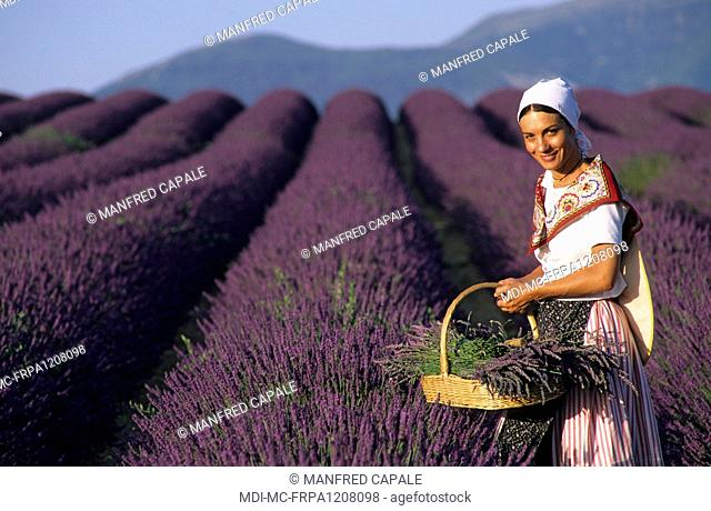 Woman in traditional clothes in a lavender field