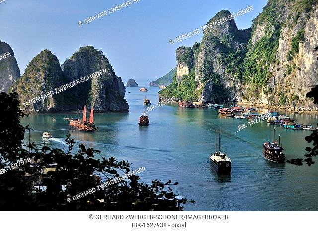 View from the top cave of Hang Sung Sot, Cave of Surprises, a cave with stalactites, toward junks in Halong Bay, Vietnam, Southeast Asia
