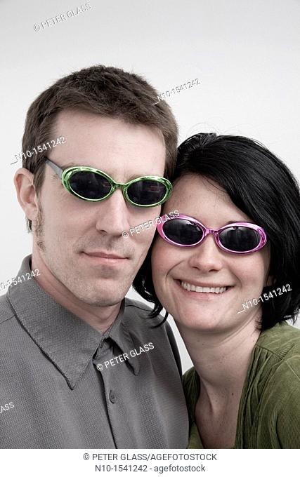 Husband and wife wearing sunglasses