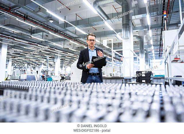 Man looking at products in factory shop floor