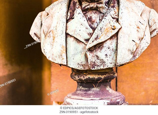 detail of historic bust showing a man in suit wearing a bow-tie, paris, ile de france, france