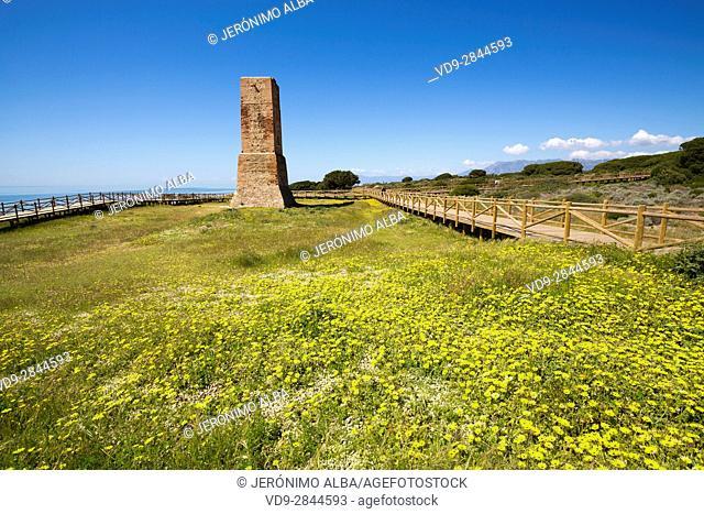 Los Ladrones moorish tower, wooden footpath, Natural Monument Dunas de Artola o Cabopino, Marbella. Malaga province Costa del Sol