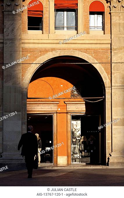 A businessman enters a shopping arcade in the Banchi Palace Piazza Maggiore Bologna Emilia-Romagna Italy