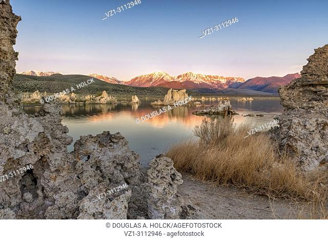 Above Mono Lake Tufa alpenglow on the Sierra Nevada Mountains display a vivid orange-red, reflecting the momentary spectacle the lake's edge, Lee Vining, CA