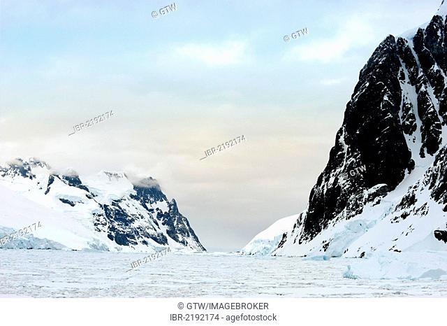 Mountains and ice floe, Lemaire channel, Antarctic Peninsula, Antarctica