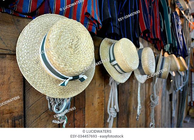 CHRISTCHURCH - DEC 04 2015:Punting hats and uniform in a boat shed on the Avon river Christchurch.It is an iconic tourist attraction of Christchurch