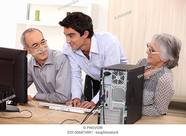 elderly couple in front of a computer
