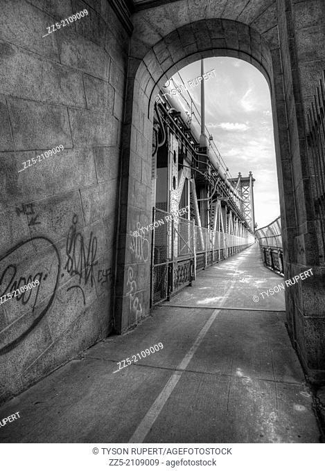 Vanishing point of pedestrian path on the manhattan Bridge with graffiti on walls