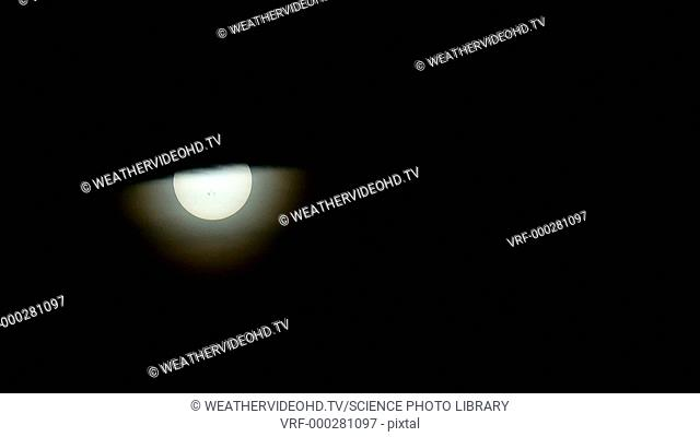 Partial solar eclipse. Time-lapse footage of the partial solar eclipse of 23 October 2014. Solar eclipses occur when the Moon passes in front of the Sun