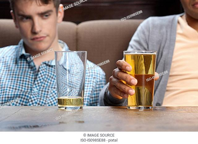 Young men in bar with beer