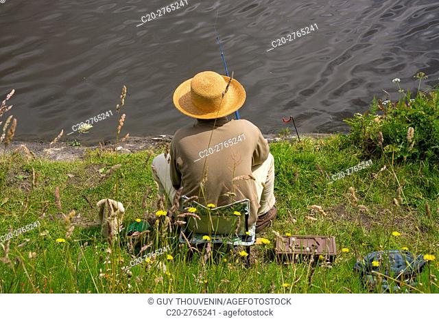 Fisherman fishing in the Loire river, with a beautiful hat, Nantes, Loire Atlantique, France