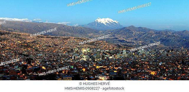 Bolivia, La Paz Department, La Paz, downtown at night and the Illimani volcano (6430 m)