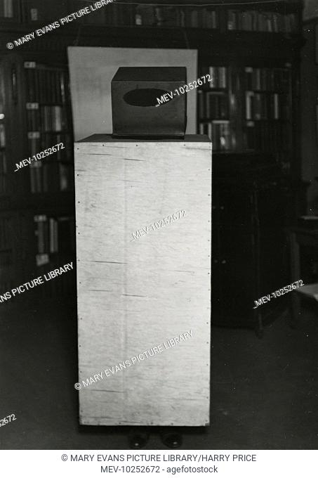 Photograph of plywood ôshroudö and visor, screening every part of the ôagentÆsö body, except for the feet, 1933. Constructed for tests with the Czechoslovak...