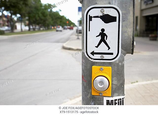 push button at pedestrian crossing crosswalk street road Winnipeg Manitoba Canada