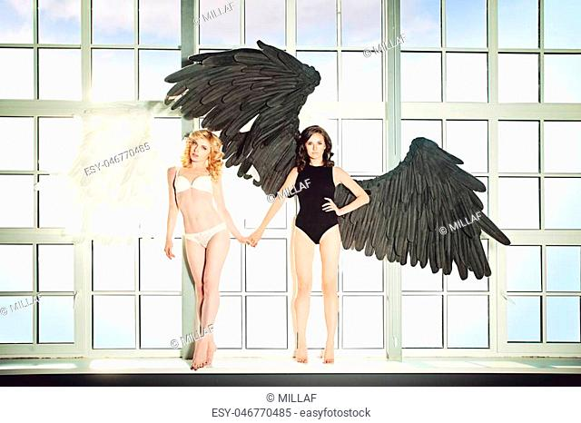 Sexy Woman with Angel Wings. Black and White Angels