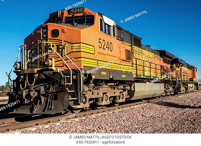 Kingman, AZ - February7, 2013: A powerful diesel locomotive is prepares to connect to its cargo of freight cars as the American economy continues its recovery