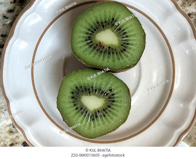 Two Kiwi fruit halves on a serving plate, Ontario, Canada