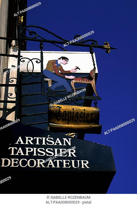 'Upholsterer' shop sign in French