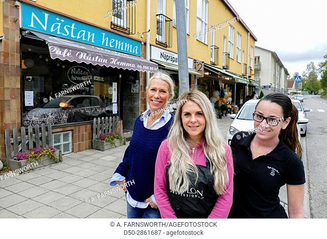 STOCKHOLM, SWEDEN Street scene in Mälarhöjden suburb. Local women shop owners