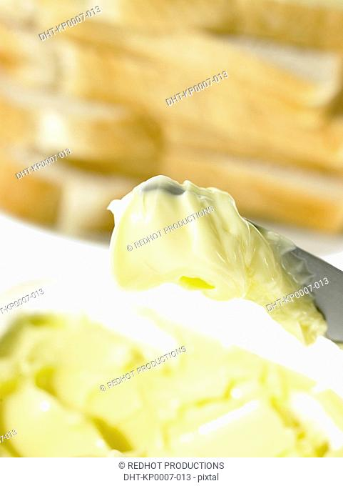 Bread slices and Butter on a knife