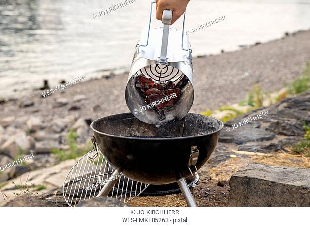 Preparing a barbecue at the riverside