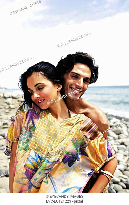 Portrait of young affectionate couple at beach
