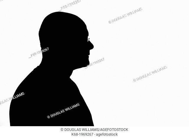 Silhouette of a middle-aged man, head and shoulders