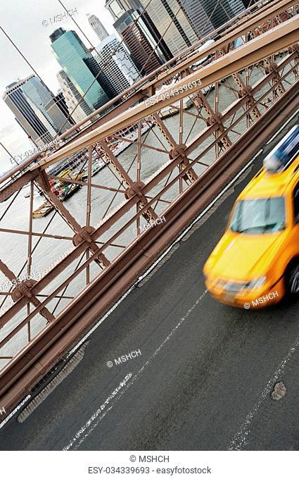 Yellow taxi on the Brooklyn Bridge, NYC
