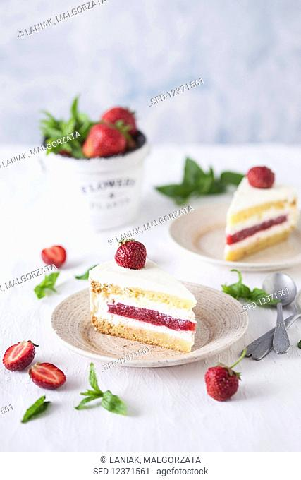 Slices of a strawberry and vanilla cake