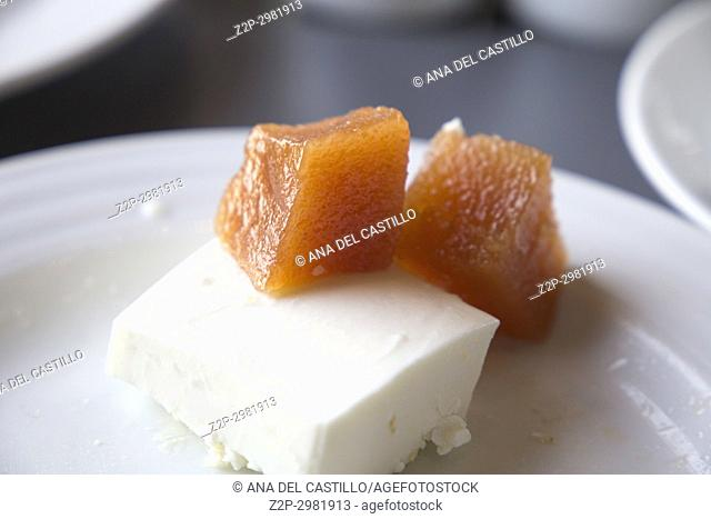 Quince with fresh cheese on plate