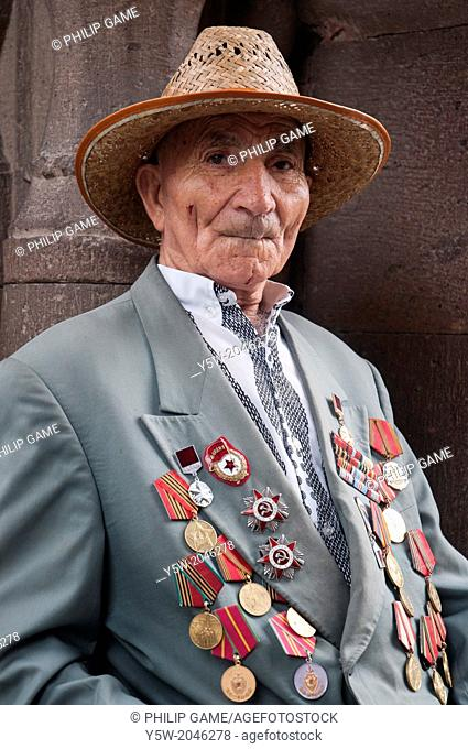An Armenian war veteran bedecked with medals, visiting the churches of the Armenian Christian Holy See at Echmiadzin, outside Yerevan