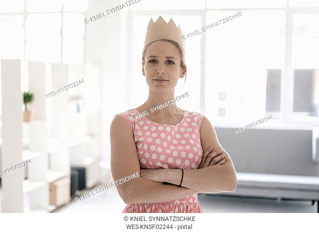 Portrait of woman wearing paper crown