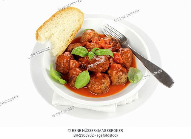 Meatballs in tomato sauce with white bread