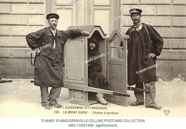 Sedan Chair porters and occupant - at Mont-Dore (Mont Dor in Occitan), formerly called Mont-Dore-les-Bains, a commune in the Puy-de-Dome department in Auvergne...