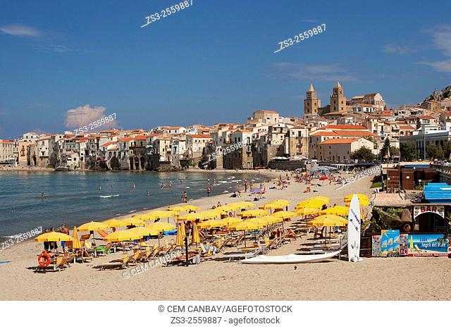 Scene from the the beach with the houses of the town and the Cathedral at the background, Cefalu, Sicily, Italy, Europe