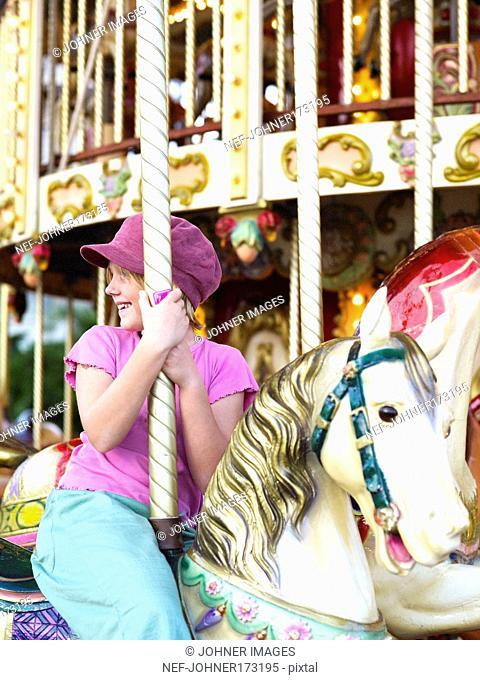 A girl on a merry-go-round