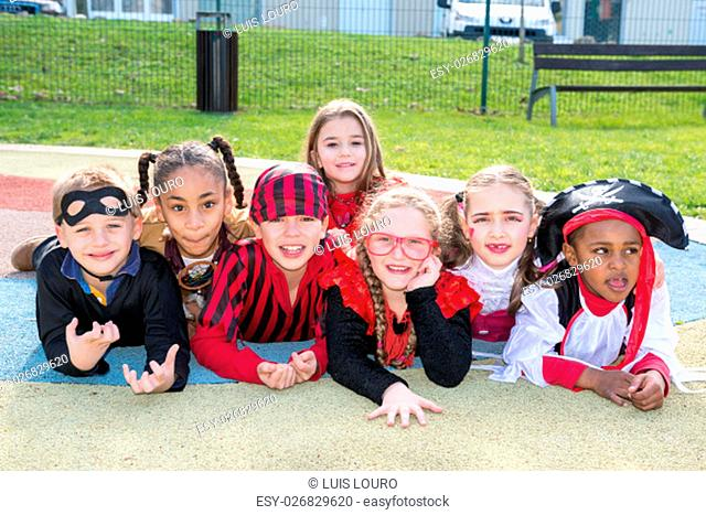 Group of kids in Haloween costumes in a park