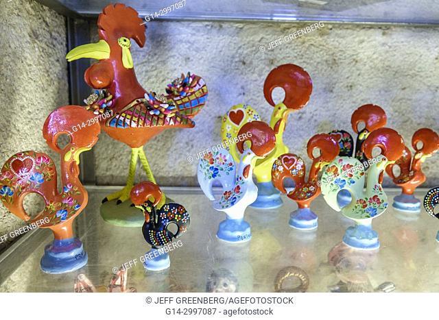 Portugal, Lisbon, historic center, centre, Mouraria, Moorish ghetto, medieval quarter, shopping, gift shop, store, souvenir, Rooster of Barcelos, figurines