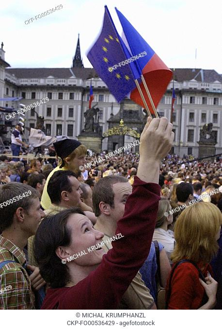 A girl waves with EU and Czech, right, flags during a concert at Prague Castle organized by supporters of Czech Republic's European Union membership on the...