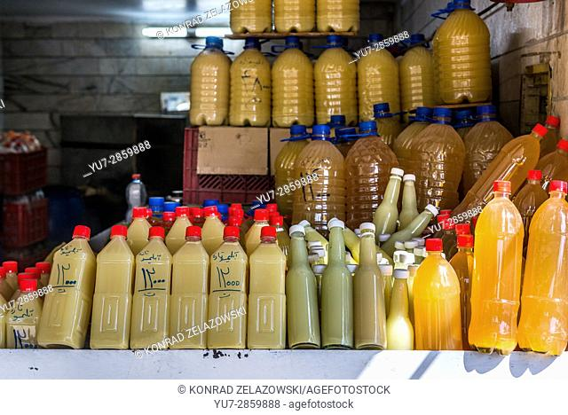 Bottles with squeezed juice in shop in Shiraz city, capital of Fars Province in Iran
