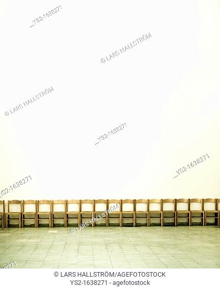 Empty chairs in a large room