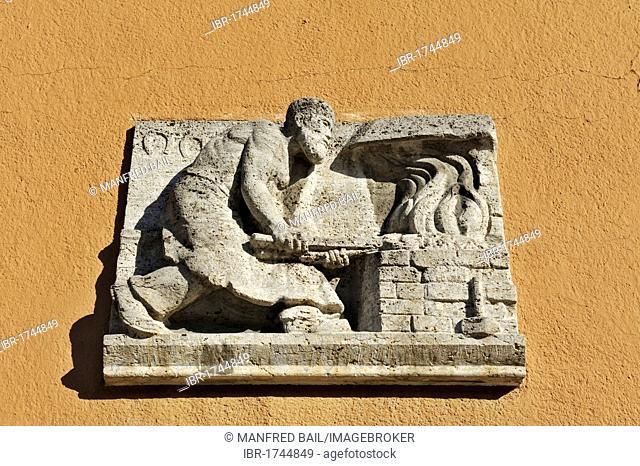 Symbolic relief of a blacksmith, Harlaching, Munich, Bavaria, Germany, Europe