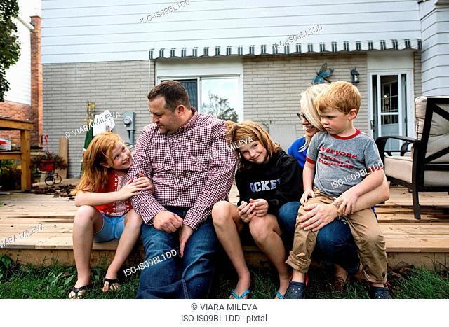 Family of five on garden terrace