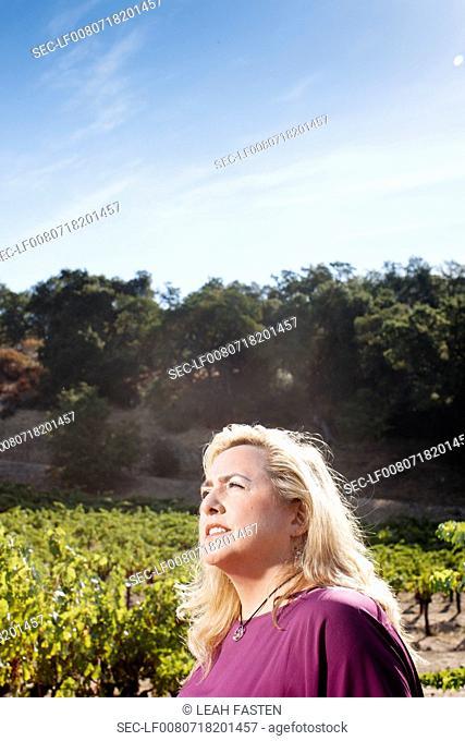 Side view of woman in field