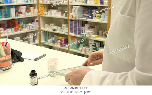 Female pharmacists counting pills
